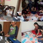 Volunteers making tactile calendars for blind