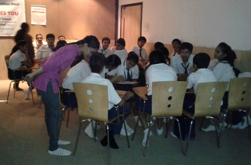 Volunteers interacting with student teams while they work on the story's ending