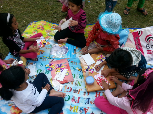 art with heart with children, origami flower, volunteering with children