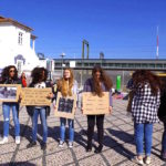 volunteers making a human chain with slogans to raise awareness about the homeless