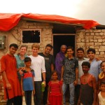 Kirti with more volunteers fixed the roof of an old lady's home in Ahmedabad slums