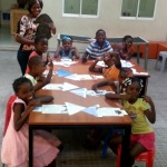 Volunteering with children – teaching shapes and sizes – assembling it together